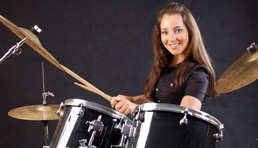 Female drummer playing drums at Pulse Music Lessons South Liverpool
