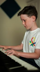 Image of a child playing the Piano at Pulse - The Music Place Liverpool.