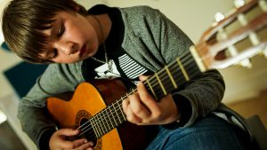 Image of a student playing Guitar at Pulse - The Music Place in Liverpool.